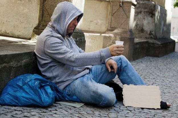 homeless man beggin on the street